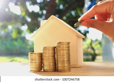 Coins placed on the wooden floor, Business Finance and Money concept, Save money for prepare in the future .Concepts saving money for House.