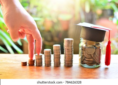 coins saving finance investment for study concept education loan and scholarships