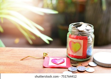coins saving in glass bottle for concept donations and philanthropy