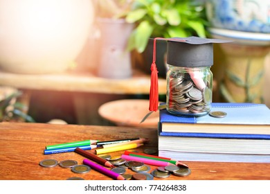 coins saving in glass bottle with hat graduation for concept investment education and scholarships