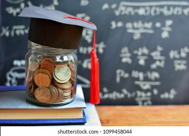 coins saving in glass bottle on book for concept investment education and scholarships