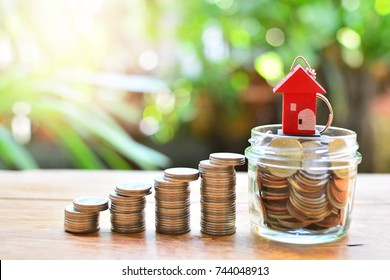 coins set to staircase up to house model for concept investment mortgage loan and finance