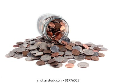 Coins spilled from a jar on white