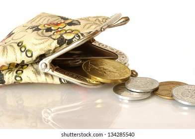 Coins spilling from purse - savings plan - business background