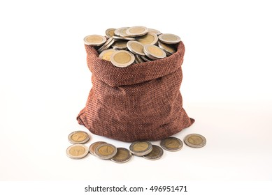 coins splash out of full of coins bag on white background showing wealth of financial , savings money concept