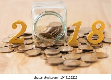 coins splash out from glass bottle and text year 2018