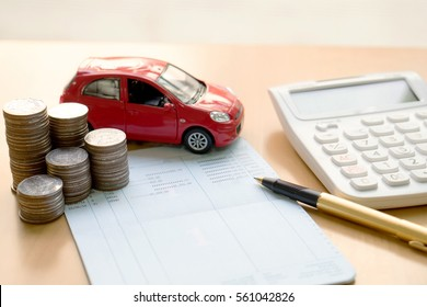 Coins stack in columns, saving book, car. Finance and banking concept.