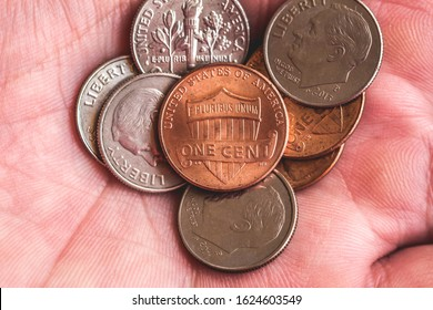 Coins Stack, Coins, Currency usd. Dollar, US coins, one cent, one cent. Coins of the United States across America in the hand of a man.