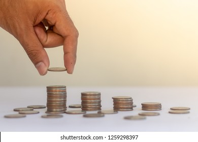 Coins stack is a graph on the sun rise background.