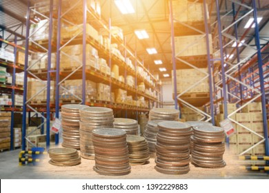 Coins stack for invest in warehouse business or Profit from investment in warehouse concepts with Blur Warehouse background