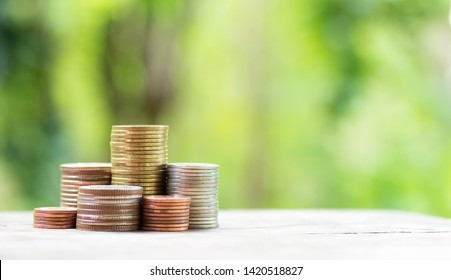 Coins stack in row on wooden background, financial concept