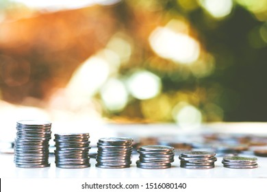 Coins stacked on borrowed background and copy space - Economy Concept - Financial and Business Freedom