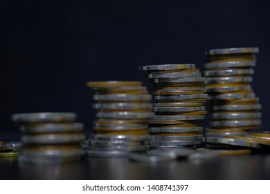 coins stacked on each other in different positions, rows for finance and business concept.