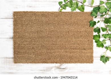 Coir doormat mock up. Floral template mockup on wooden background