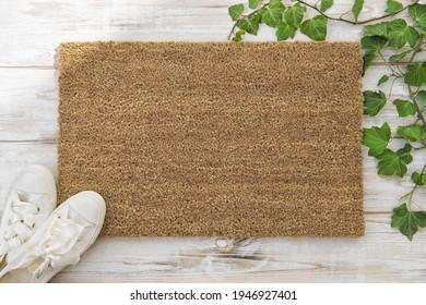 Coir doormat mockup Green plant spring wooden background