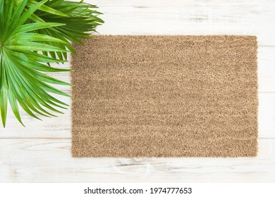 Coir doormat mockup with palm leaves decoration. Floral template mock up