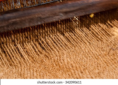 Coir matting being woven on a hand  operated coir loom at a co-operative in south India.