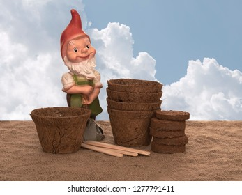 Coir plant pots and compressed compost with wooden labels and generic garden gnome. Environmentally friendly spring gardening. Sky composited background.