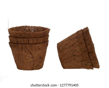 Coir plant pots isolated on white. Environmentally friendly spring gardening. Peat substitute.