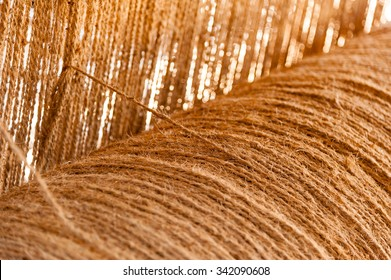 Coir yarn being prepared for use on a hand operated loom to produce matting at a co-operative in south India.