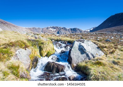 Coire an t-Sneachda in summer, one of the Cairngorm's northern corries with a burn/stream and small waterfall in the foreground.