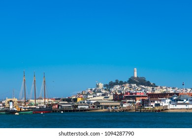 Coit Tower of San Francisco with blue sky,  view from ocean side
