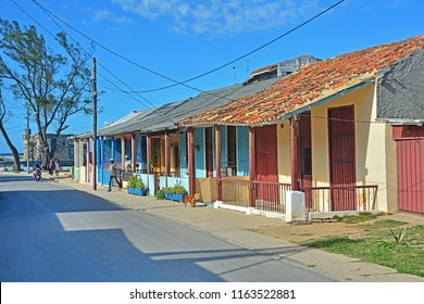 COJIMAR, EASTERN HAVANA, CUBA - FEBRUARY 26, 2018 - Houses in the fishing village east of Havana with Castillo de Cojimar in the background, inspiration for Ernest Hemingway's The Old Man and the Sea