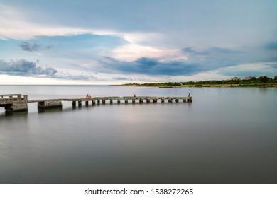 Cojimar, Havana, Cuba. August 24 2019. Few people fishing on a pier.