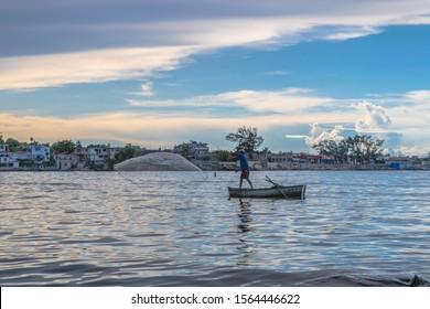 Cojimar, Havana, Cuba. August 24 2019. Fisherman tossing his net to the bay.