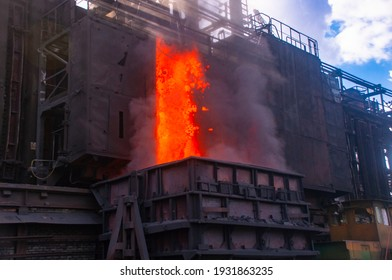 coke and chemicals plant. Unloading hot coke from a by-product coke battery. Hot coke is loaded onto a wagon.