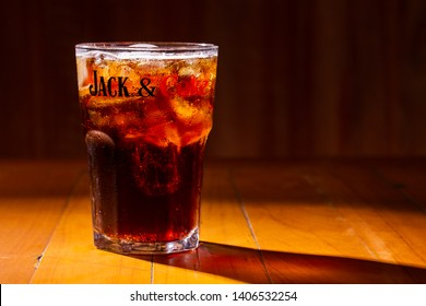 Coke with jack Daniel's of Brazil on wooden background. May, 2019, Ribeirao Preto, Brazil