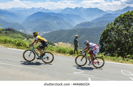 COL D'ASPIN,FRANCE - JUL 15: The cyclists Tom Leezer and Sebastien Chavanel, climbing,the road to Col D'Aspin in Pyrenees during the stage 11 of Le Tour de France on July 15, 2015.