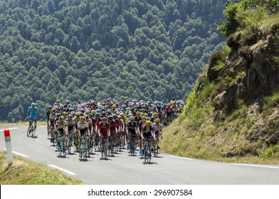 COL D'ASPIN,FRANCE - JUL 15: The peloton climbing the road to Col D'Aspin  in Pyrenees Mountains during the stage 11 of Le Tour de France on July 15, 2015.