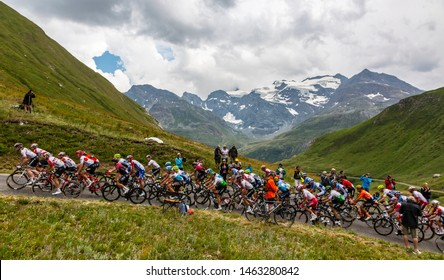 Col de Iseran, France - July 26, 2019: The Peloton climbing the road to Col de Iseran during the stage 19 of Le Tour de France 2019.