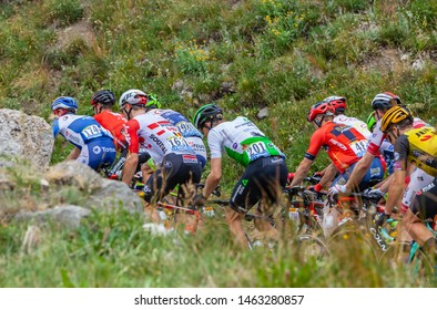 Col de Iseran, France - July 26, 2019: Rear view of the peloton climbing the road to Col de Iseran during the stage 19 of Le Tour de France 2019.