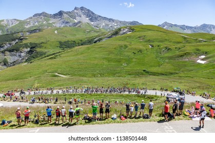 Col de la Madeleine, France - July 19, 2018: The peloton climbing the road to Col de la Madeleine in the French Alps, during the stage 12 of Le Tour de France 2018
