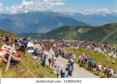 Col de la Madeleine, France - July 19, 2018:Image of Mont Blanc covered by clouds in the background and the peloton climbing the road to Col de la Madeleine, during the stage 12 of Le Tour de France.