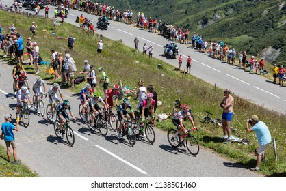 Col de la Madeleine, France - July 19, 2018: Julian Alaphilippe of Quick-Step Floors Team wearing Polka Dot Jersey climbing in the peloton the road to Col de la Madeleine in the French Alps.