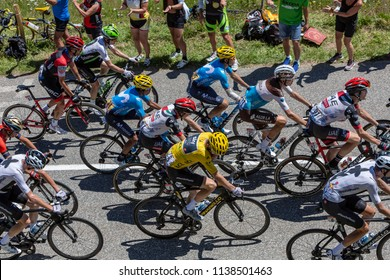 Col de la Madeleine, France - July 19, 2018: Geraint Thomas of Team Sky in  Yellow Jersey climbing in the peloton the road to Col de la Madeleine in the Alps, during the stage 12 of Le Tour de France
