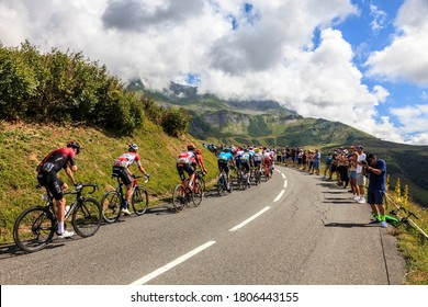 Col de la Madeleine, France - August 24, 2020: Christopher Froome, of  Team Ineos riding in the peloton on  the road to Col de la Madeleine during the 3rd stage of Criterium du Dauphine 2020.