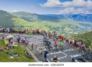 COL DE PEYRESOURDE,FRANCE-JUL 23: Group of cyclists climbing the road to Col de Peyresourde in Pyrenees during the stage 17 of Le Tour de France on 23 July 2014.