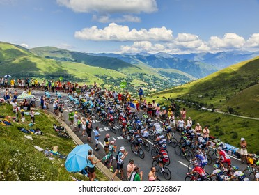 COL DE PEYRESOURDE,FRANCE-JUL 23: The peloton climbing the road to Col de Peyresourde in Pyrenees Mountains during the stage 17 of  Le Tour de France on 23 July 2014.