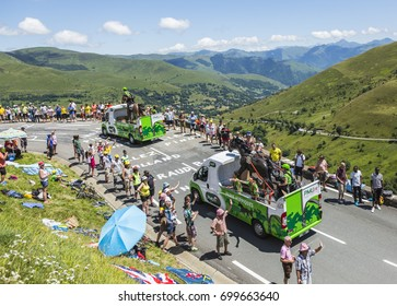 COL DE PEYRESOURDE,FRANCE-JUL 23: PMU vehicles passing in the Publicity Caravn on the road to Col de Peyresourde in Pyrenees Mountains during the stage 17 of  Le Tour de France 2014.