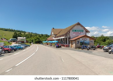 COL DE SCHLUCHT, FRANCE - JUNE 20, 2018: bar, brasserie and parking lot at the col de Schlucht in France. It is one of the biggest summits in the vosgue regin in the Alsace.