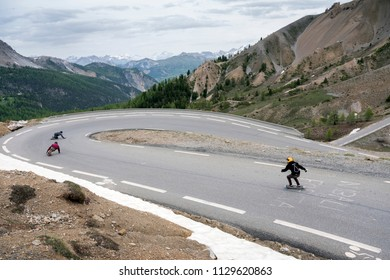 col d'izoard, france, 10 june 2018: person on skateboard leaves col d'izoard in the french alps of haute provence at great speed