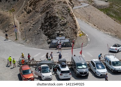 Col du Galibier/France-Aug 1, 2018 Bicycle riders are photographed in front of the signposts after climbing the high alpine pass. Col du Galibier is at the border between Savoie and Hautes Alpes.