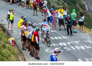 Col du Glandon, France - July 24, 2015: The French cyclist Benoit Vaugrenard of FDJ Team,climbing the road to Col du Glandon in Alps, during the stage 19 of Le Tour de France 2015.