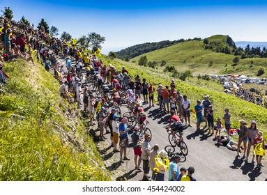 COL DU GRAND COLOMBIER,FRANCE-JUL 17: The peloton riding on the road to Col du Grand Colombier in Jura Mountains during the stage 15 of Tour de France 2016.