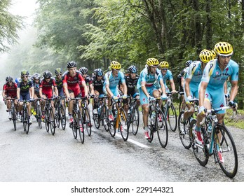 COL DU PLATZERWASEL,FRANCE - JUL 14: Astana Team and BMC Team ride in front of the peloton on the road to mountain pass Platzerwasel, Vosges Mountains,during Le Tour de France on July 14 2014.