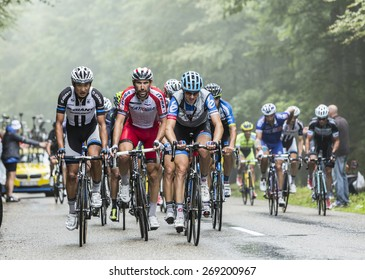 COL DU PLATZERWASEL,FRANCE - JUL 14: The peloton on the climbing road to mountain pass Platzerwasel in Vosges Mountains, during Le Tour de France on July 14 2014